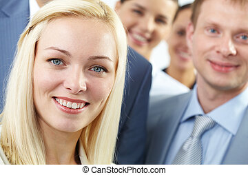 Beautiful business lady - Young businesswoman smiling among...