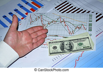 State of business - Male hand showing different charts and...
