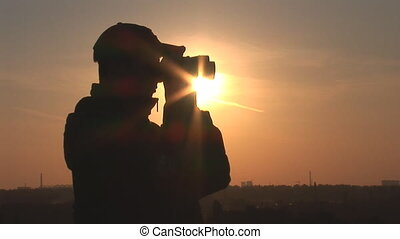 binocular 8 - young man looking through binoculars at sunset