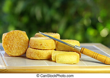 Yellow cheese of sheep at Portugal, and knife.