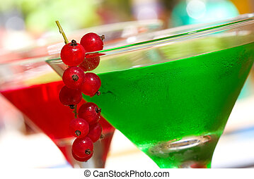green cocktail with red currant