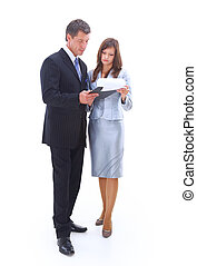 Portrait of a cheerful business couple standing together with folded arms on white background