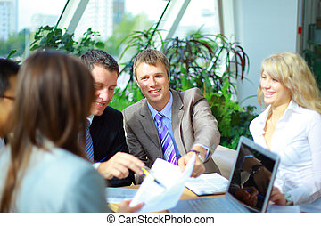 Business meeting - manager discussing work with his...