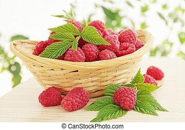 juicy raspberries - fresh is juicy raspberries in the woven...