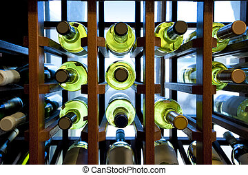 Wine bottles in wooden rack located in a small country store