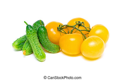 yellow tomatoes and cucumbers on a white background