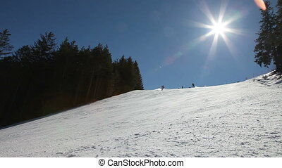 Ski slop   - Ski slope with skiers and snowboarders