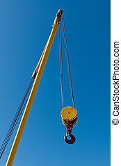 Hoist - A pulley and hook hoist mechanism hanging from a...