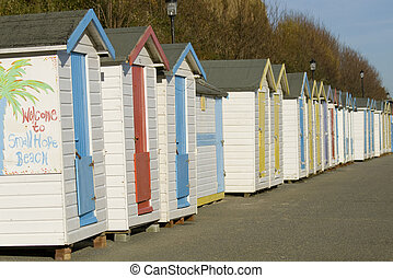 Colourful beach huts - A line of colourful traditional beach...