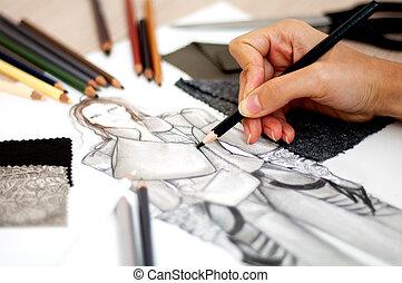 fashion designer - Fashion designer is drawing an artistic...