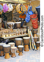 Djembe and african craft - African merchant stand with...