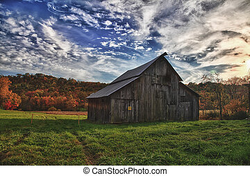 Fall colors and barn - Early fall colors outlining a...