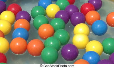 balls   - Colorful balls floating in a swimming pool