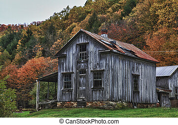 Old homestead in the fall - Old homestead located in...