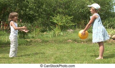 kids play with ball - Kids play with yellow ball outdoor