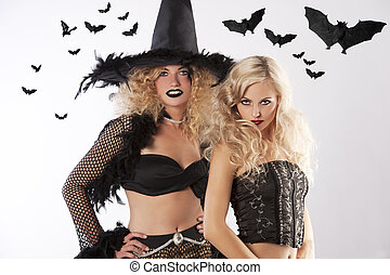 the two dark magic witches - two young beautiful girls...