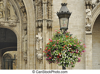 flowering lamp post in grand place - foreshortening of...