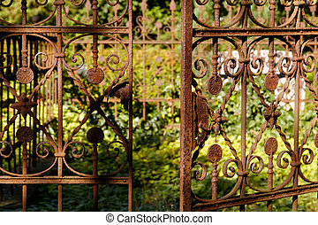 Opening in Rusty Cemetery Fence - A heavily rusted cemetery...