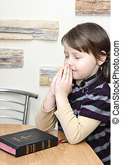 girl - little girl praying over the bible