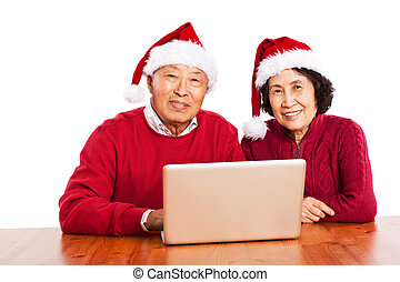 Senior Asian grandparents using computer - A shot of senior...