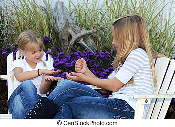 childs game - Little girls playing rock, paper, scissor game...