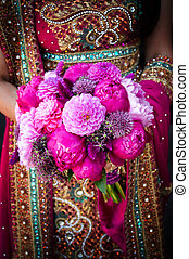 Indian brides hands holding bouquet - Image of an Indian...
