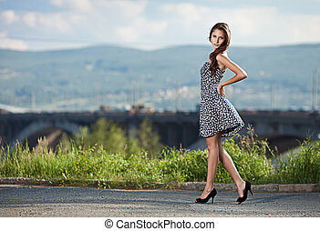 young carefree woman at the street in city