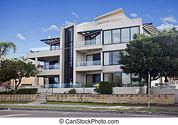 modern block of units - modern block of apartments against a...