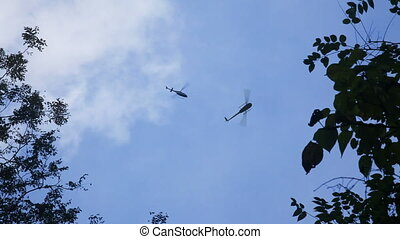 Helicopters on rescue mission - Three ambulance helicopters...