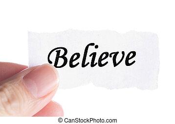 Believe word in finger, word on piece tear paper