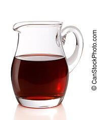 Jug of wine - A jug filled with red wine isolated on a white...