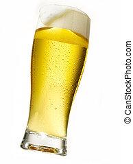 beer glass - ice cold foaming beer in crisp sun licht