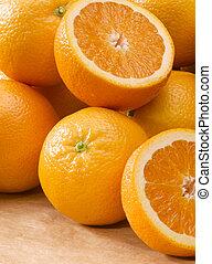 orange - pile of open and closed fresh oranges