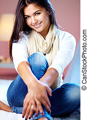 Pretty girl - Portrait of young girl posing at camera at...