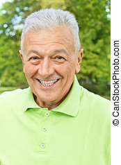 happy senior man outdoors - Closeup portrait of happy senior...