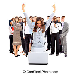 business woman with her hands raised while working on laptop...