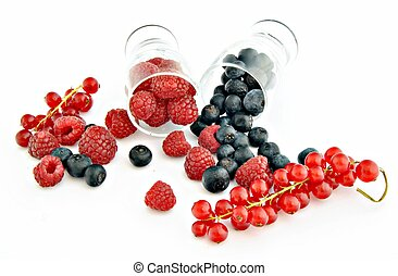 Two glass jars, one with red fruits and others with black...