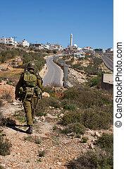 Israeli soldiers patrol in palestinian village - Israeli...