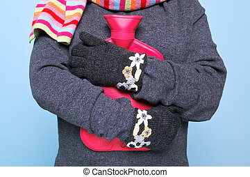 Woman holding a hot water bottle