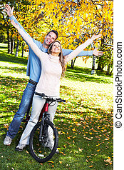 Young couple. - Happy young couple with bicycle in the park.