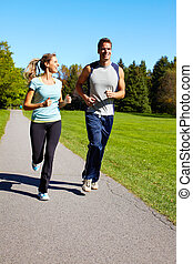 Jogging couple - Young couple jogging in park Health and...