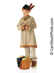 Native American Contributions - An elementary boy dressed as...