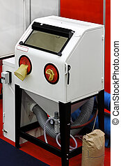 Sand blasting cabinet in metal work shop