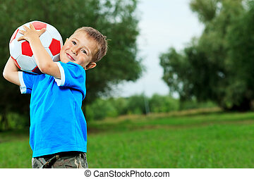 playing boy - Shot of a cute laughing boy with a ball...