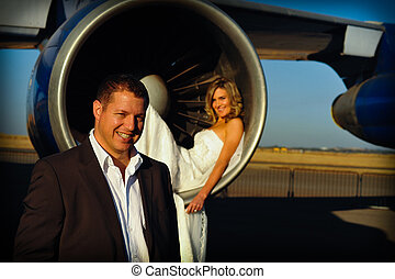 couple standing at intake of engine