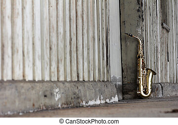 old grungy saxophone with old retro background