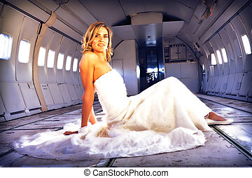 wedding model laying in airplane