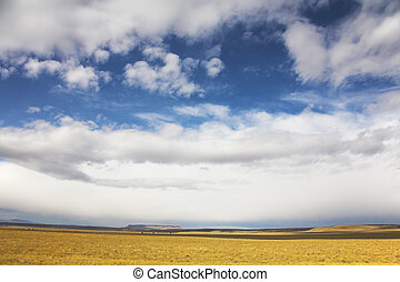 The grandiose sky of Montana above the American prairie in...