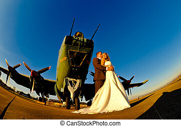 wedding couple with warplane - sexy young adult wedding...