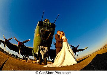 wedding couple with warplane - sexy young adult wedding...